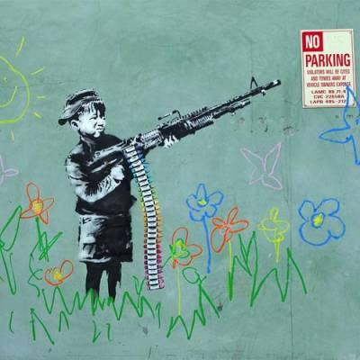 b2ap3_thumbnail_Banksy-street-art-foto-opere-portavoce-generazione-anti-sistema-02.jpg