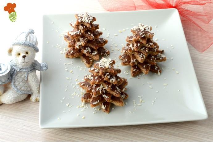 Albero Di Natale Di Biscotti.Alberelli Di Natale Di Biscotti Con Nutella Fatta In Casa E Cocco Ricetta Senza Burro Greenme