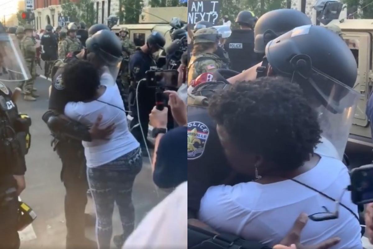 Abbraccio poliziotto e manifestante